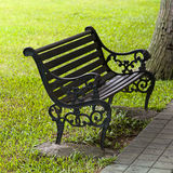 A Bench. The park bench, and the green grass background Stock Photo