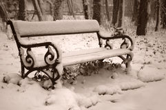 Bench. Covered with a layer of fresh snow. Sepia tones Royalty Free Stock Photos