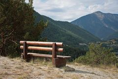 Bench. Wooden bench in the mountains royalty free stock photography