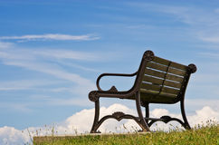 Bench. Wooden bench against a blue sky royalty free stock photo