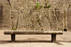 Bench. Stone bench against an old wall of castle in San Marino, Europe Royalty Free Stock Photo