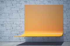 Bench with ad space. Modern orange bus stop bench with copy space. Brick wall background and shadow underneath. Advertisement concept. Mock up, 3D Rendering Stock Photography