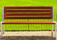 Bench against a background of green grass Royalty Free Stock Images