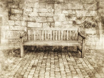 Bench against wall Stock Image