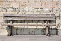 Bench against the wall, loneliness Royalty Free Stock Image