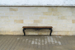 Bench against the wall. A solitary bench near the wall Stock Images