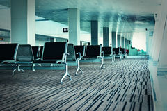 Bench in the airport hall. Photo with color filters and film gra Royalty Free Stock Photography