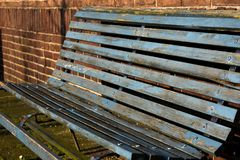 Metal Wood Steel Bench Mossy Old Rusty Empty Simple Sit On Blue Brown Chain Weathered Texture stock photos