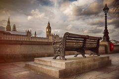 Bench along River Thames with a view of Big Ben Royalty Free Stock Image