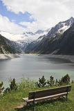 Bench along Schlegeis Reservoir, Austria Stock Images