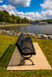 Bench along the shore of the North East River in North East, Mar Royalty Free Stock Images
