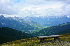 Bench in austria alps mountains Stock Photography