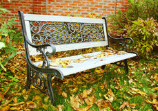 Bench in an autumn garden. Forged bench in an autumn garden Royalty Free Stock Images