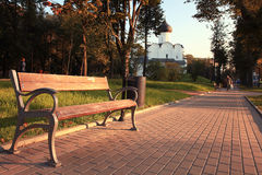 Bench in autumn park at sunset Royalty Free Stock Photos