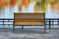 Bench in the autumn park. Royalty Free Stock Photo