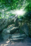 Bench on the background of large stones Royalty Free Stock Image