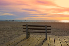 Bench on a background of ocean. Empty bench on the background of the ocean at sunset. empty bench on the beach Stock Photo
