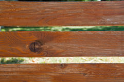 Bench background. Wooden brown Bench stripes background - summer time Royalty Free Stock Images