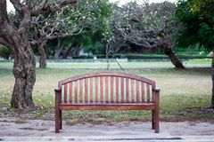 The Bench with backrest roadside in park. The Bench with backrest roadside in park Royalty Free Stock Images