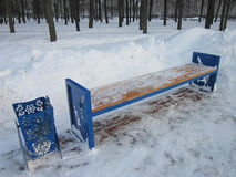 Bench with a ballot box. New benches and ballot boxes stand in winter city park stock photo