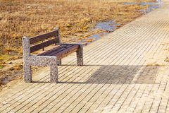Bench at Baltic sea pathway in Gdansk. Royalty Free Stock Images