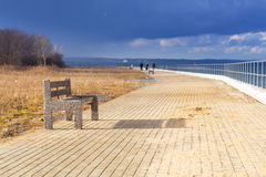 Bench at Baltic sea pathway in Gdansk Stock Photos