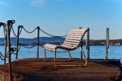 Bench on bank of  north sea. Bench on water of north sea Oslo Norway Stock Photography
