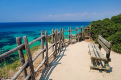Bench at the beach. Landscape of a bench overlooking the beach Stock Images