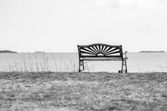 Bench on the beach royalty free stock image