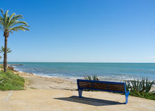 Bench on a beach promenade Stock Image