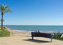 Bench on a beach promenade Stock Image