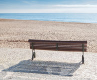 Bench on the beach of the sea. Stock Photo