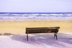 Bench beach sea blue sky nature Royalty Free Stock Photos