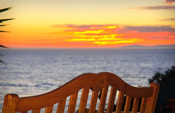 Bench On The Beach At Sunset Stock Image