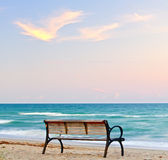 Bench by the beach Stock Images
