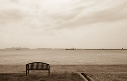 Bench on a beach Royalty Free Stock Photography