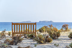 Bench on the beach under a tree with mediterranean sea view Royalty Free Stock Photography