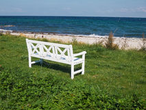 Bench on a beautiful beach Royalty Free Stock Image