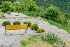Bench with beautiful mountain forest scenery Stock Photo