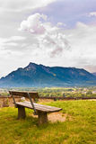 Bench with a beautiful mountain landscape view. Royalty Free Stock Image