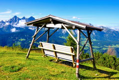 Bench in beautiful nature of Alps mountains Royalty Free Stock Photo