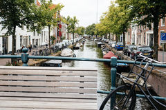 Bench and bike on the bridge. Picturesque cityscape with beautif Royalty Free Stock Photography