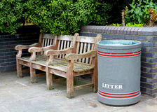 Bench and bin. An outdoor bench and litter bin Stock Image