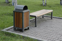 Bench and bin in the park Stock Image