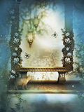 The bench in blue misty garden Royalty Free Stock Image