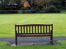 Bench and bowling green Stock Photo