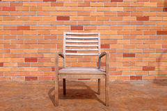Bench with brick wall Stock Images