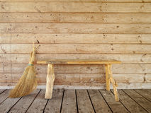 Bench and broom Royalty Free Stock Images