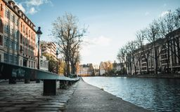 Bench on the Canal Saint-Martin royalty free stock image
