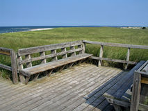 Bench at Cape Cod. Bench overlooking shore at Cape Cod Stock Photos